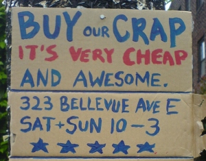 "bargain sign ""Buy our crap"""